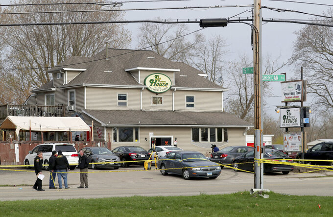 Officials investigate the scene of a deadly shooting at Somers House Tavern in Kenosha, Wis., Sunday, April 18, 2021. Several people were killed and two were seriously wounded in a shooting at the busy tavern in southeastern Wisconsin early Sunday, sheriff's officials said. (Mike De Sisti/Milwaukee Journal-Sentinel via AP)