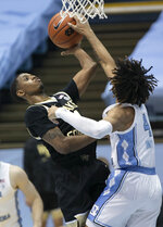 North Carolina's Leaky Black, right, defends against Wake Forest's Daivien Williamson (4) during the second half of an NCAA college basketball game Wednesday, Jan. 20, 2021, in Chapel Hill, N.C. (Robert Willett/The News & Observer via AP)