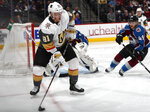 Vegas Golden Knights center Jonathan Marchessault looks to pass the puck as Colorado Avalanche goaltender Philipp Grubauer, back left, and defenseman Samuel Girard watch during the second period of an NHL hockey game Wednesday, March 27, 2019, in Denver. (AP Photo/David Zalubowski)