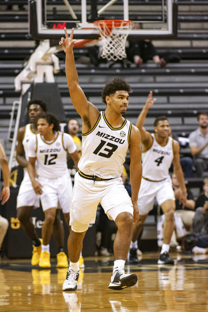 Missouri's Mark Smith celebrates a three point shot during the first half of an NCAA college basketball game against Southern Illinois, Sunday, Dec. 15, 2019, in Columbia, Mo. (AP Photo/L.G. Patterson)