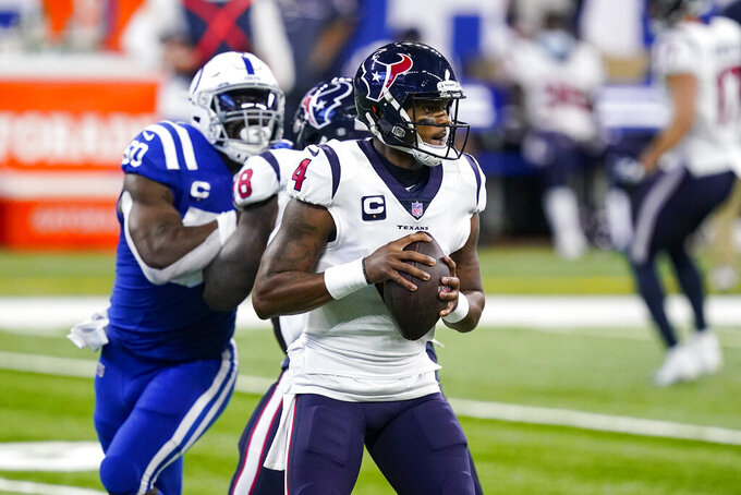 Houston Texans quarterback Deshaun Watson (4) throws against the Indianapolis Colts in the first half of an NFL football game in Indianapolis, Sunday, Dec. 20, 2020. (AP Photo/Darron Cummings)