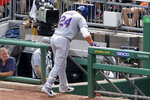 New York Mets' Robinson Cano makes his way to the dugout after injuring his left hamstring while rounding first base during the fourth inning of a baseball game against the Pittsburgh Pirates in Pittsburgh, Sunday, Aug. 4, 2019. (AP Photo/Gene J. Puskar)