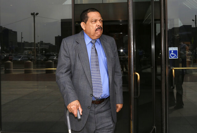 """FILE - In this Aug. 22, 2013 file photo, former El Salvadoran military Col. Inocente Orlando Montano departs federal court, in Boston. Spain's National Court on Friday Sept. 11, 2020, has condemned the former Salvadoran colonel to 133 years in prison for the slaying of five Spanish priests in El Salvador more than three decades ago. They ruled that Inocente Orlando Montano, a former colonel who served as El Salvador's vice minister for public security during the country's 1979-1992 civil war, was responsible for the 1989  """"terrorist assassinations."""" (AP Photo/Steven Senne, File)"""