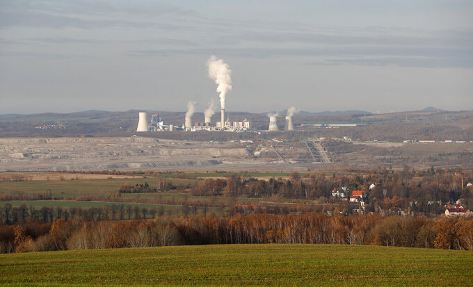 FILE - This Tuesday, Nov. 19, 2019 file photo shows the Turow lignite coal mine and Turow power plant near the town of Bogatynia, Poland. European Union's top court has on Friday, May 21, 2021 ordered Poland to immediately stop extracting brown coal at the Turow mine on the border with the Czech Republic and Germany. The Czech Republic filed in March for an injunction, saying the mine drains away water from its inhabited areas. (AP Photo/Petr David Josek, file)