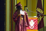 Blessing Ovie holds up her diploma during Traverse City High School's commencement on Friday, June 4, 2021, at Lars Hockstad Auditorium in Traverse City, Mich. Ovie who was born in Nigeria, came to Traverse City from Morocco through a United Nations refugee minor program, and will attend Western Michigan University in the fall. (Jan-Michael Stump/Traverse City Record-Eagle via AP)