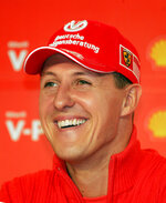 FILE - In this Oct. 19, 2006, file photo, Ferrari F1 driver Michael Schumacher, of Germany, smiles during a press conference in Sao Paulo, Brazil. Schumacher's family, in a statement Wednesday, Jan. 2, 2019, has asked for understanding as it continues to keep details of his health private ahead of the seven-time Formula One champion's 50th birthday. Schumacher suffered serious head injuries in an accident while he was skiing with his teenage son Mick in the French Alps at Meribel on Dec. 29, 2013. (AP Photo/Daniel Maurer, File)