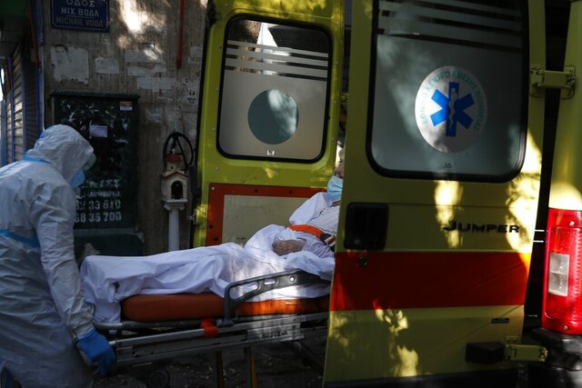 A paramedic with a special outfit to protect against coronavirus, pushes a stretcher with a patient inside an ambulance after dozens of elderly people have been found positive in COVID-19 at a nursing home in Athens, Thursday, Oct. 1, 2020. Nationwide, Greece has been experiencing a resurgence of the virus, with the number of new daily cases often topping 300, and both deaths and the number of those in intensive care units rising. (AP Photo/Thanassis Stavrakis)