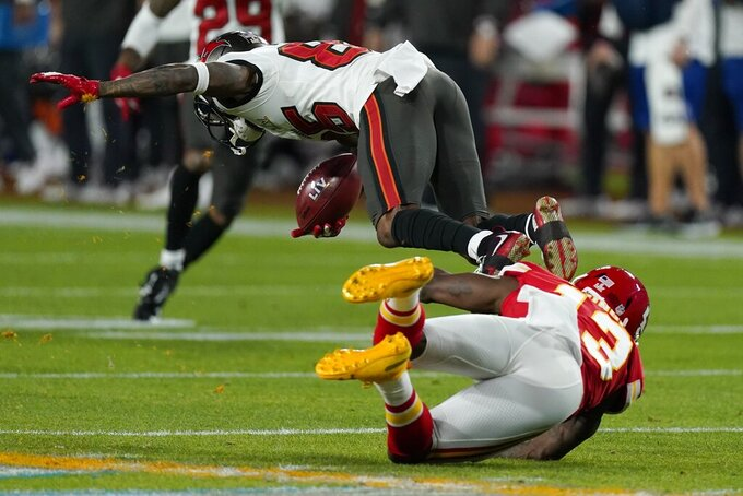 Kansas City Chiefs' Byron Pringle tackles Tampa Bay Buccaneers' Jaydon Mickens during the first half of the NFL Super Bowl 55 football game Sunday, Feb. 7, 2021, in Tampa, Fla. (AP Photo/Mark Humphrey)