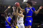 Notre Dame's Nikola Djogo (13) goes up for a shot as Pittsburgh's Eric Hamilton, left, Onyebuchi Ezeakudo (31), second from left, and Justin Champagnie (11) defend during the first half of an NCAA college basketball game Wednesday, Feb. 5, 2020, in South Bend, Ind. (AP Photo/Robert Franklin)
