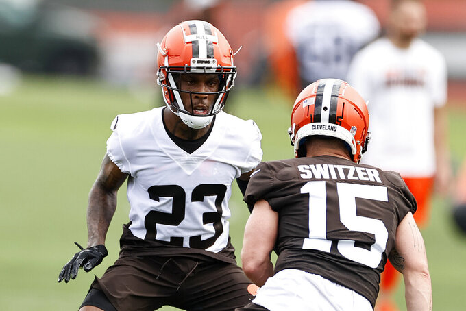 Cleveland Browns cornerback Troy Hill (23) defends against wide receiver Ryan Switzer (15) during an NFL football practice at the team's training facility Wednesday, June 9, 2021, in Berea, Ohio. (AP Photo/Ron Schwane)