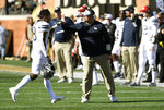 Pittsburgh's V'Lique Carter (19) gets a high-five from head coach Pat Narduzzi as he goes to the sideline during the second half of their NCAA college football game against Wake Forest on Saturday, Nov. 17, 2018, in Winston-Salem, N.C. (AP Photo/Woody Marshall)