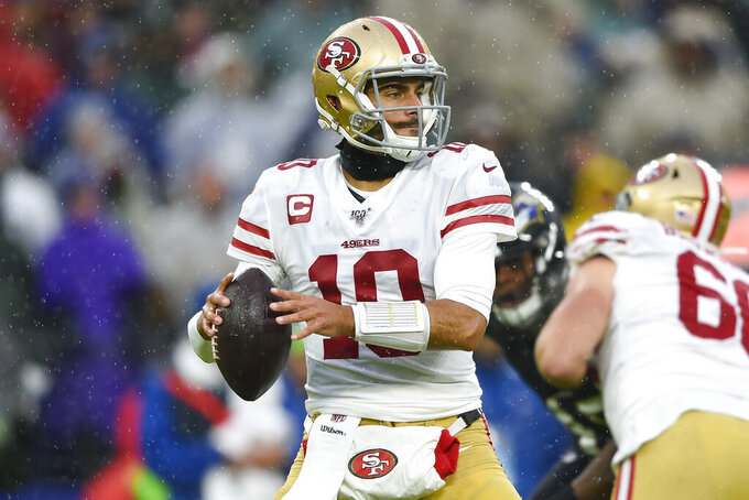 San Francisco 49ers quarterback Jimmy Garoppolo looks to pass the ball during the first half of an NFL football game against the Baltimore Ravens, Sunday, Dec. 1, 2019, in Baltimore, Md. (AP Photo/Gail Burton)