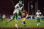 Oregon tight end Hunter Kampmoyer (48) celebrates a touchdown with wide receiver Devon Williams (2) during the first quarter of an NCAA college football game for the Pac-12 Conference championship against Southern California, Friday, Dec 18, 2020, in Los Angeles. (AP Photo/Ashley Landis)