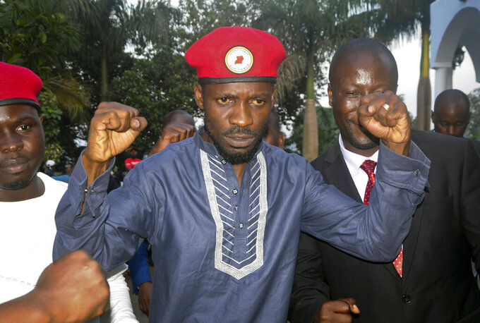 FILE - In this Thursday May 2, 2019 file photo, Ugandan pop star and opposition figure Bobi Wine, whose real name is Kyagulanyi Ssentamu, greets his followers as he arrives home after being released from prison, im Kampala. Deadly violence and repressive measures have alarmed observers as Uganda prepares to vote on Jan. 14, 2021, with longtime President Yoweri Museveni challenged by young singer and lawmaker Bobi Wine, who has captured the imagination of many across Africa in a generational clash (AP Photo/Ronald Kabuubi, file)