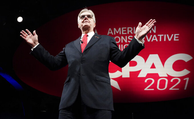 FILE - In this July 9, 2021, file photo, Texas Lt. Gov. Dan Patrick speaks during opening general session of the Conservative Political Action Conference (CPAC) in Dallas. Lt. Gov. Patrick blamed rising hospitalization and death rates from COVID-19 on unvaccinated Black people, and his comments were quickly denounced as racist. Patrick made the comments Thursday, Aug. 19, 2021, night on a Fox News segment. (AP Photo/LM Otero, File)