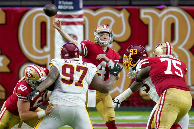 San Francisco 49ers quarterback Nick Mullens (4) throws over Washington Football Team defensive tackle Tim Settle (97) during the first half of an NFL football game, Sunday, Dec. 13, 2020, in Glendale, Ariz. (AP Photo/Ross D. Franklin)