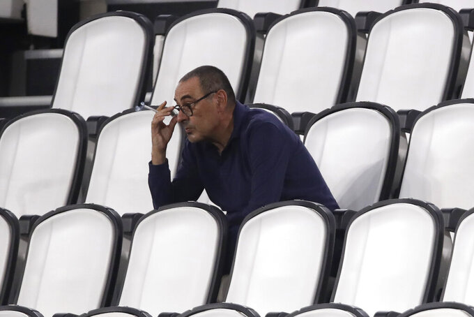 Juventus' head coach Maurizio Sarri smokes during a Serie A soccer match between Juventus and Roma, at the Allianz stadium in Turin, Italy, Saturday, Aug.1, 2020. (AP Photo/Luca Bruno)