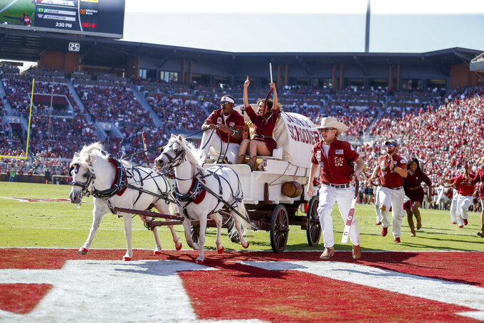 The Oklahoma Sooner Schooner makes a run following a Sooner touchdown in the second quarter of an NCAA college football game against West Virginia in Norman, Okla., Saturday, Oct. 19, 2019. (AP Photo/Alonzo Adams)