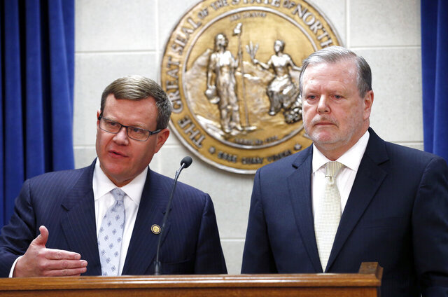 FILE - In this March 28, 2017, file photo, Republican leaders Rep. Tim Moore, left, and Sen. Phil Berger hold a news conference in Raleigh, N.C. The two powerful state lawmakers  want President Donald Trump and Joe Biden to have an extra presidential debate. (Chris Seward/The News & Observer via AP, File)
