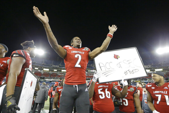 Louisville wide receiver Devante Peete (2) celebrates in the final minutes of Louisville's win over Mississippi State in the Music City Bowl NCAA college football game Monday, Dec. 30, 2019, in Nashville, Tenn. Louisville won 38-28. (AP Photo/Mark Humphrey)
