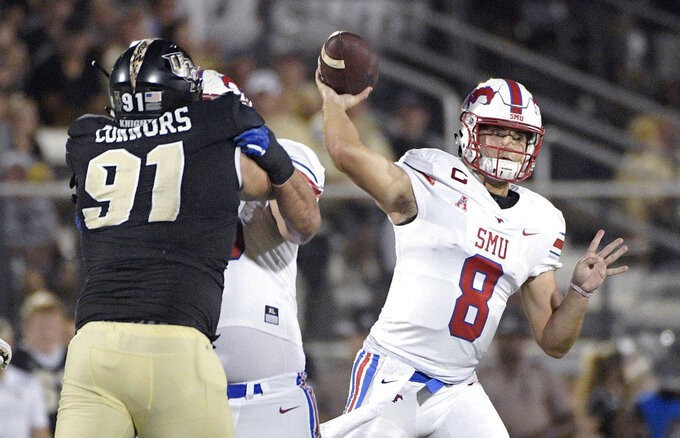 FILE- In this Oct. 6, 2018, file photo, SMU quarterback Ben Hicks (8) throws a pass in front of Central Florida defensive lineman Joey Connors (91) during the first half of an NCAA college football game in Orlando, Fla. After initially committing to Houston and planning to enroll there in January 2015, Hicks switched to SMU. (AP Photo/Phelan M. Ebenhack, File)