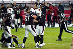 Arizona Cardinals kicker Zane Gonzalez, right, celebrates his game winning field goal with offensive guard Justin Pugh (67)during the second half of an NFL football game against the Seattle Seahawks, Sunday, Oct. 25, 2020, in Glendale, Ariz. The Cardinals won 37-34 in overtime. (AP Photo/Rick Scuteri)