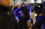 A member of the Greek Police Special Forces secures an area upon the arrival of the Libyan Gen. Khalifa Hifter in Athens, Thursday, Jan. 16, 2019. Greece will block any European peace deal on Libya unless an agreement between the internationally-recognized government in Tripoli and Turkey on maritime borders is scrapped, Greek Prime Minister Kyriakos Mitsotakis warned Thursday. (AP Photo/Michael Varaklas)