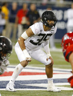 FILE - In this Oct. 27, 2018, file photo, is Oregon linebacker Troy Dye (35) during an NCAA college football game against Arizona in Tucson, Ariz. With the return of senior leaders Justin Herbert and Troy Dye, expectations are high for the Oregon Ducks this season. (AP Photo/Rick Scuteri, File)