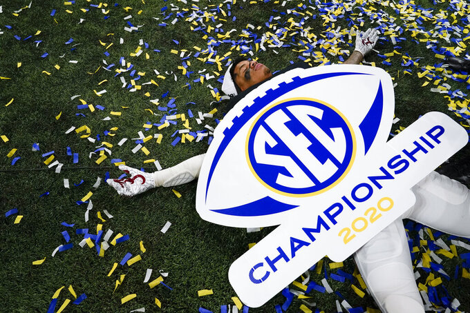 An Alabama player celebrates victory against Florida after the Southeastern Conference championship NCAA college football game, Sunday, Dec. 20, 2020, in Atlanta. Alabama won 52-46. (AP Photo/Brynn Anderson)