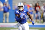 Kansas running back Khalil Herbert runs for a first down during the first half of an NCAA college football game against Indiana State, Saturday, Aug. 31, 2019, in Lawrence, Kan. (AP Photo/Charlie Riedel)