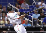 Miami Marlins' J.T. Realmuto hits a single during the fourth inning of a baseball game against the San Francisco Giants on Wednesday, June 13, 2018, in Miami. (AP Photo/Lynne Sladky)