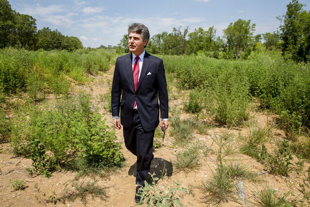 FILE - In this July 25, 2018 file photo, Stephen Bell, president and CEO of the Arkadelphia Regional Economic Development Alliance, shows parts of the 1000-acre site that he hoped would be a $1.8 billion Chinese paper mill in Arkadelphia, Ark. On Monday, Feb. 10, 2020, it was reported that Arkadelphia plans to pitch the site to other industrial prospects amid growing signs that the mill project's future is at risk because of trade tensions. (AP Photo/Karen E. Segrave, File)