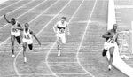 FILE - In this Oct. 15, 1964, file photo, Bob Hayes of United States, right, wins the men's 100-meter final during the Summer Olympic Games at the National Stadium in Tokyo. (AP Photo/File)
