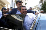 Greek Prime Minister and Syriza party leader Alexis Tsipras enters in a car after casts his ballot at a polling station in Athens, on Sunday, July 7, 2019. Greeks are voting in the first parliamentary election since their country emerged from three successive international bailouts but is still struggling to emerge from a crippling nearly decade-long financial crisis. (AP Photo/Yorgos Karahalis)