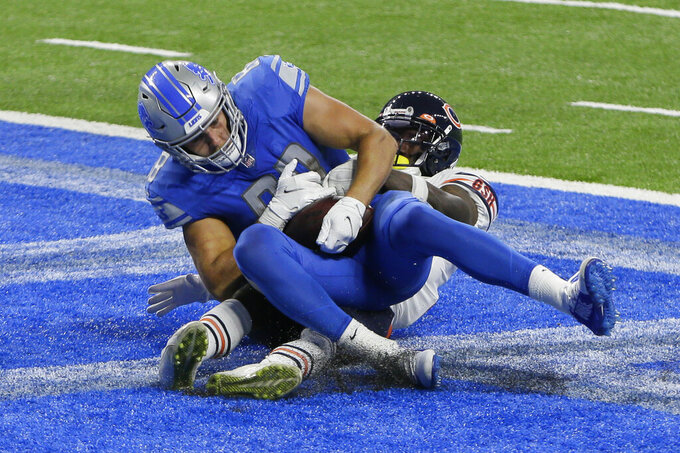 Detroit Lions tight end T.J. Hockenson (88) catches a four-yard touchdown pass against the Chicago Bears in the second half of an NFL football game in Detroit, Sunday, Sept. 13, 2020. (AP Photo/Duane Burleson)
