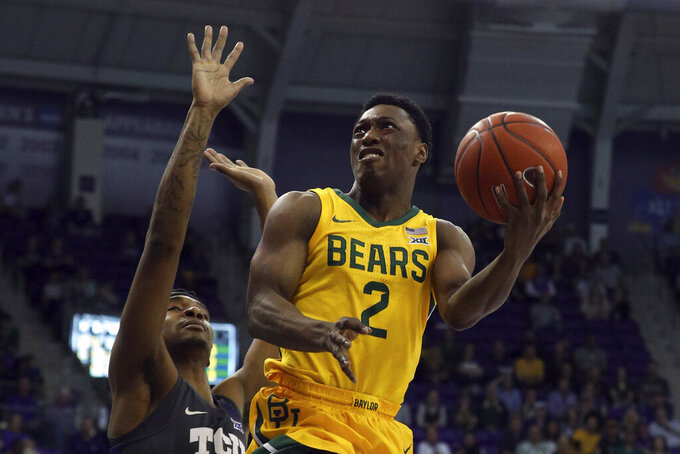 Baylor guard Devonte Bandoo (2) goes up for a shot against TCU forward Diante Smith (10) during the first half of an NCAA college basketball game on Saturday, Feb. 29, 2020 in Fort Worth, Texas. (AP Photo/Richard W. Rodriguez)