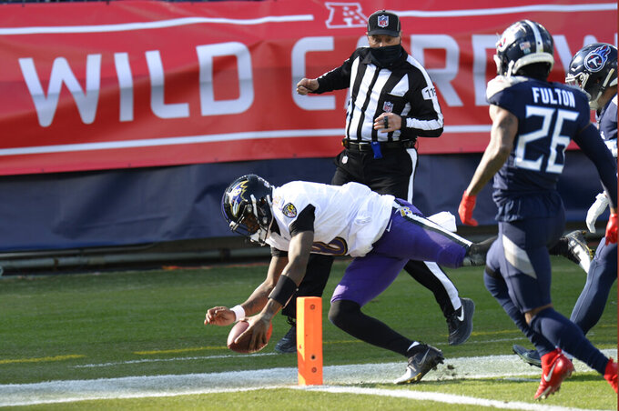 Baltimore Ravens quarterback Lamar Jackson (8) scores a touchdown on a 48-yard run against the Tennessee Titans in the first half of an NFL wild-card playoff football game Sunday, Jan. 10, 2021, in Nashville, Tenn. (AP Photo/Mark Zaleski)
