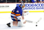 New York Islanders goaltender Jaroslav Halak (41) of Slovakia makes a save during the first period of an NHL hockey game against the Columbus Blue Jackets in New York, Tuesday, Feb. 13, 2018. (AP Photo/Kathy Willens)