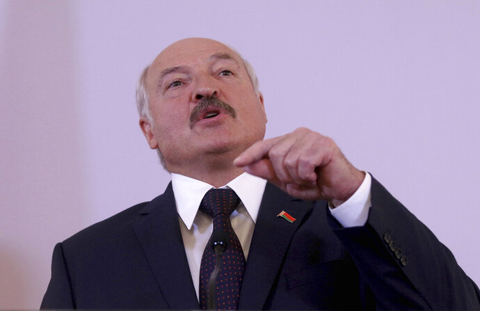Belarusian President Alexander Lukashenko addresses the media after talks with Austrian President Alexander Van der Bellen at the Hofburg palace in Vienna, Austria, Tuesday, Nov. 12, 2019. (AP Photo/Ronald Zak)