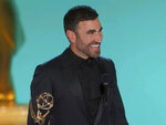 """In this video grab issued Sunday, Sept. 19, 2021, Brett Goldstein accepts the award for outstanding supporting actor in a comedy series for """"Ted Lasso"""" at the 73rd Primetime Emmy Awards at L.A. Live in Los Angeles. (Television Academy via AP)"""