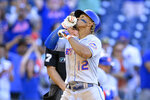 New York Mets' Francisco Lindor (12) celebrates his two-run home run during the ninth inning of the first baseball game of a doubleheader against the Washington Nationals, Saturday, Sept. 4, 2021, in Washington. The Mets won 11-9 in extra innings. (AP Photo/Nick Wass)