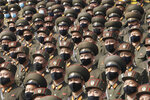 Soldiers wearing face masks to help curb the spread of the coronavirus rally to welcome the 8th Congress of the Workers' Party of Korea at Kim Il Sung Square in Pyongyang, North Korea, Monday, Oct. 12, 2020. (AP Photo/Jon Chol Jin)