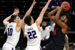 Maryland forward Donta Scott, right, shoots against Northwestern forward Miller Kopp, left, and forward Pete Nance during the first half of an NCAA college basketball game in Evanston, Ill., Wednesday, March 3, 2021. (AP Photo/Nam Y. Huh)