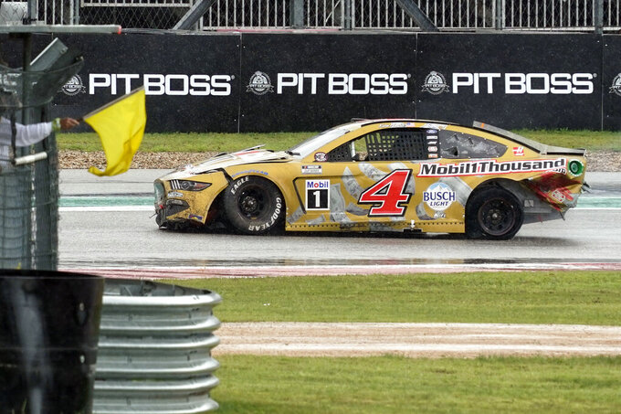 Kevin Harvick (4) drives past a yellow flag in Turn 15 after a crash during a NASCAR Cup Series auto race at Circuit of the Americas in Austin, Texas, Sunday, May 23, 2021. (AP Photo/Chuck Burton)