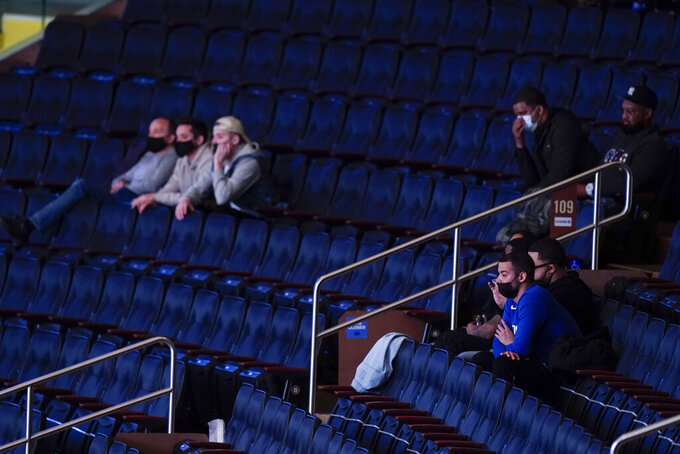 Fans watch during the first half of an NCAA college basketball game between Providence and DePaul in the Big East conference tournament Wednesday, March 10, 2021, in New York. (AP Photo/Frank Franklin II)