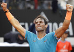 FILE - In this May 19, 2019, file photo, Rafael Nadal, of Spain, celebrates after his victory over Novak Djokovic, of Serbia, at the end of their final match at the Italian Open tennis tournament in Rome. The Italian Open would have been the last significant clay-court tuneup ahead of the French Open, which has been postponed until September due to the coronavirus outbreak. Nadal won his ninth trophy in Italy a year ago, before going on to claim his record-extending 12th championship in Paris. (AP Photo/Gregorio Borgia, File)