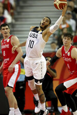 United States' Jayson Tatum reach for the ball during a Group E match against Turkey for the FIBA Basketball World Cup at the Shanghai Oriental Sports Center in Shanghai on Tuesday, Sept. 3, 2019. The United States beat Turkey 93:92.(AP Photo/Ng Han Guan)