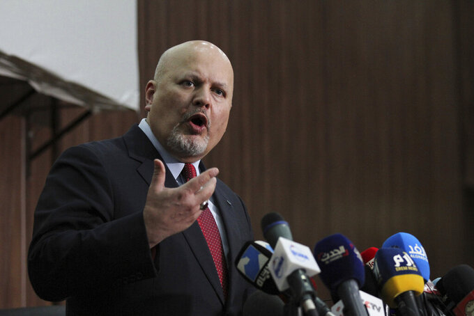 """FILE - In this Thursday Aug. 12, 2021 file photo, Karim Ahmed Khan, International Criminal Court chief prosecutor, speaks during a news conference at the Ministry of Justice in the Khartoum, Sudan. The chief prosecutor of the International Criminal Court sought urgent clearance Monday, Sept. 27 from the court's judges to resume investigations of war crimes and crimes against humanity in Afghanistan, saying that under the country's new Taliban rulers """"there is no longer the prospect of genuine and effective domestic investigations"""" in the country. Judges at the global court authorized an investigation by Prosecutor Karim Khan's predecessor, Fatou Bensouda, in March last year. (AP Photo/Marwan Ali, file)"""