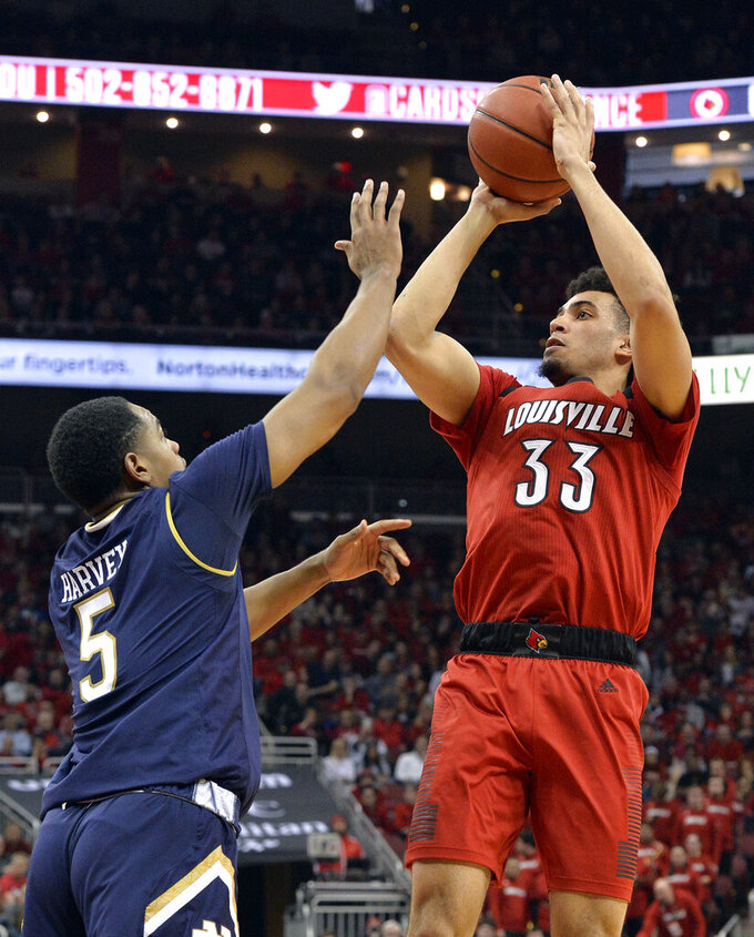 Louisville forward Jordan Nwora (33) shoots over the defense of Notre Dame guard D.J. Harvey (5) during the second half of an NCAA college basketball game in Louisville, Ky., Sunday, March 3, 2019. Louisville won 75-61. (AP Photo/Timothy D. Easley)
