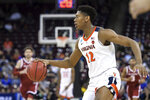 Virginia guard De'Andre Hunter looks to make a play against Oklahoma during the second half of a second-round game in the NCAA men's college basketball tournament Sunday, March 24, 2019, in Columbia, S.C. Virginia defeated Oklahoma 63-51. (AP Photo/Sean Rayford)